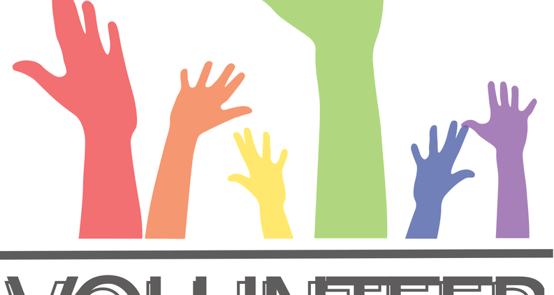 Hands in the air with word Volunteer