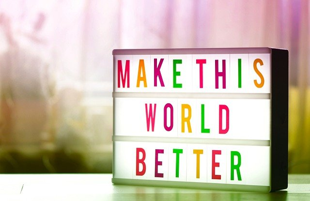 Coloured light box with the words 'Make this world better'